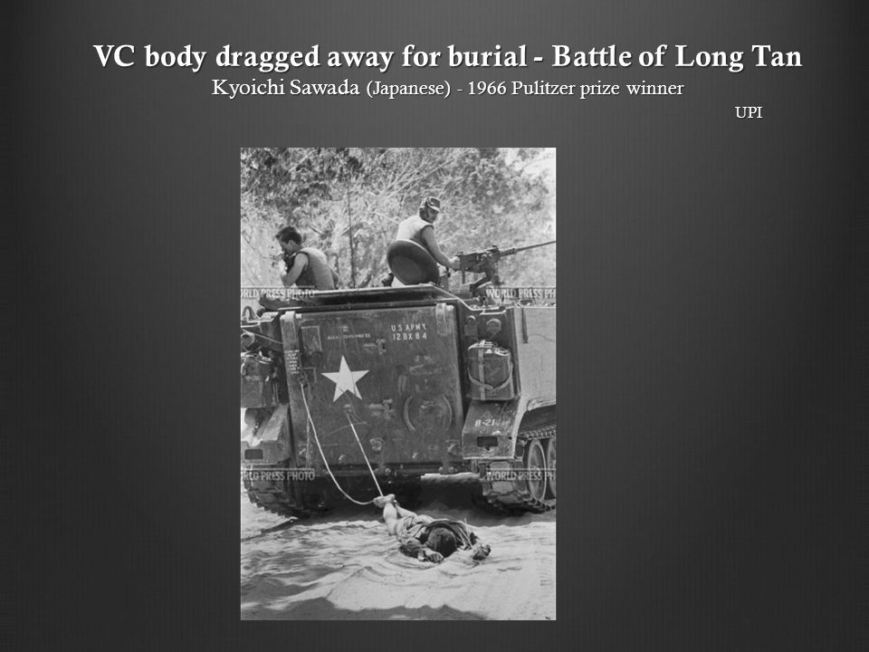 VC body dragged away for burial - Battle of Long Tan Kyoichi Sawada (Japanese) - 1966 Pulitzer prize winner UPI
