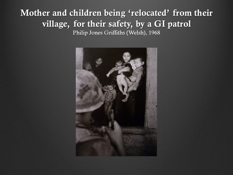 Mother and children being 'relocated' from their village, for their safety, by a GI patrol Philip Jones Griffiths (Welsh), 1968