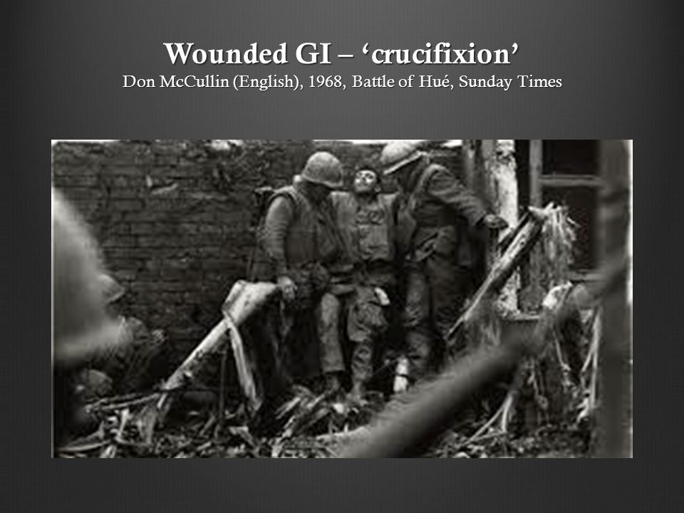 Wounded GI – 'crucifixion' Don McCullin (English), 1968, Battle of Hué, Sunday Times