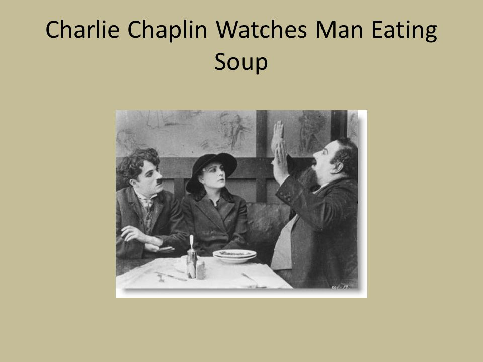 Charlie Chaplin Watches Man Eating Soup