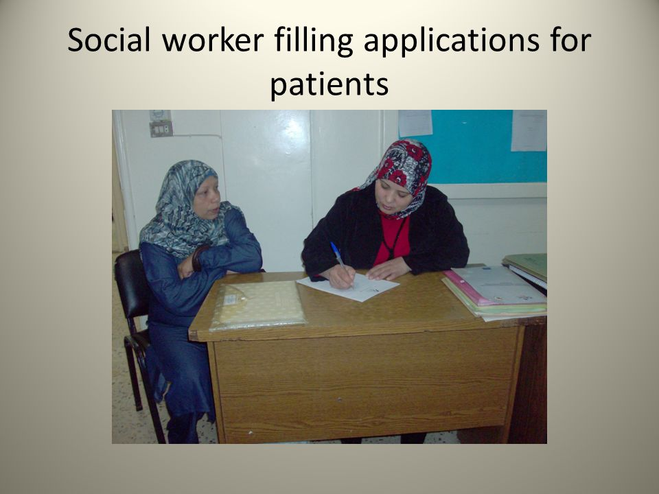 Social worker filling applications for patients