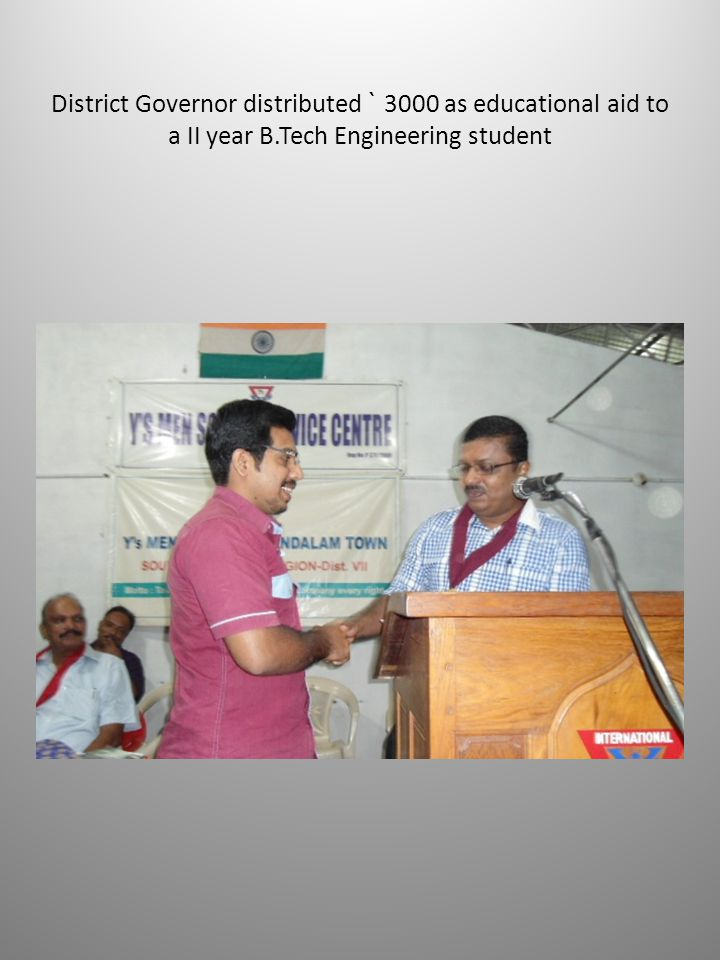 District Governor distributed ` 3000 as educational aid to a II year B.Tech Engineering student