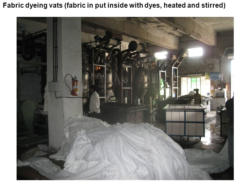 Fabric dyeing vats (fabric in put inside with dyes, heated and stirred)