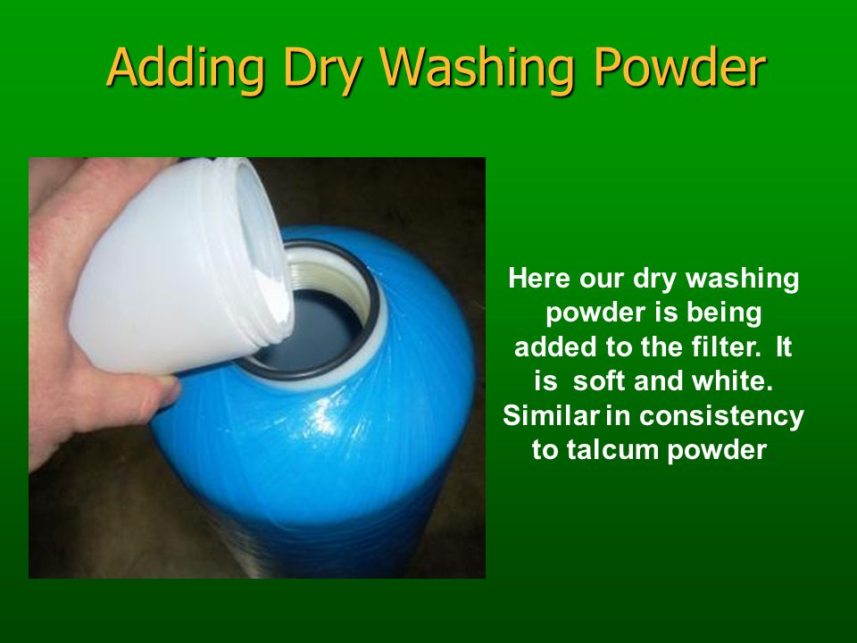 Adding Dry Washing Powder Here our dry washing powder is being added to the filter.