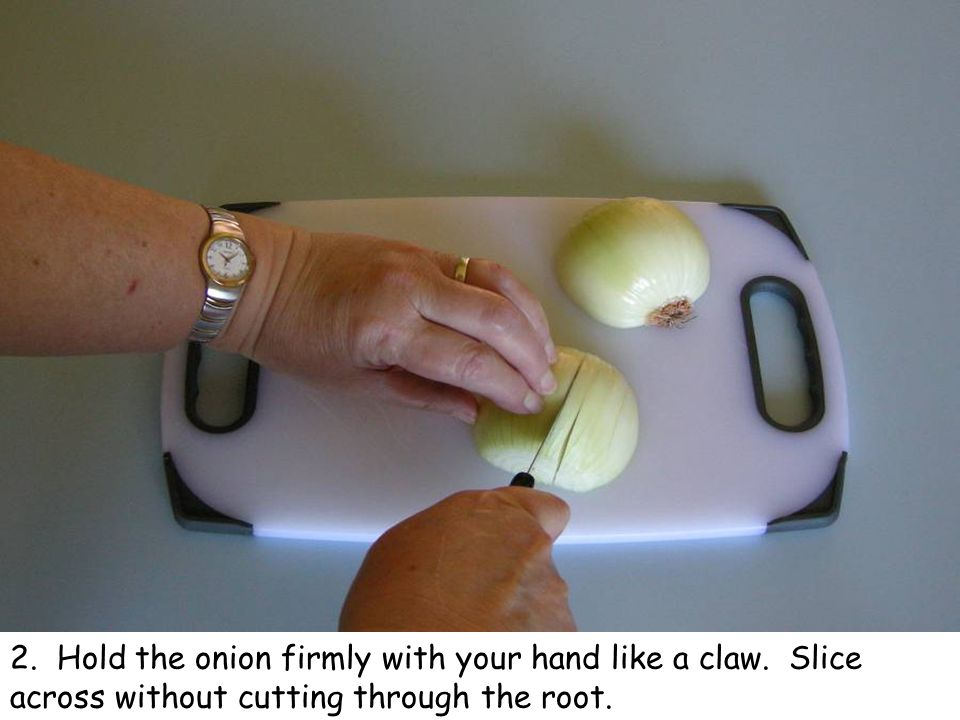 3. Turn the onion round and still holding it like a claw, slice in the other direction.