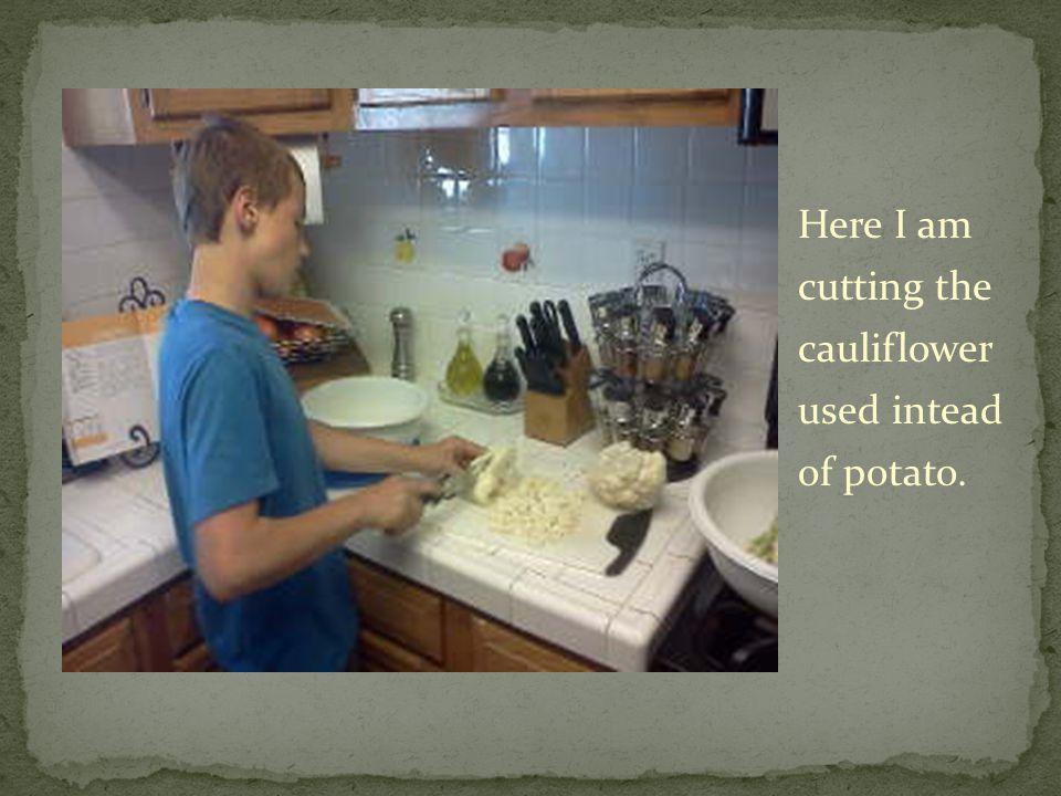 Here I am cutting the cauliflower used intead of potato.