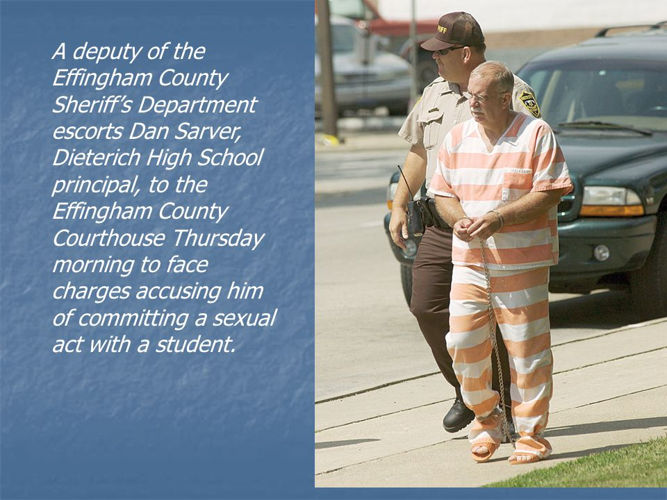A deputy of the Effingham County Sheriff's Department escorts Dan Sarver, Dieterich High School principal, to the Effingham County Courthouse Thursday morning to face charges accusing him of committing a sexual act with a student.