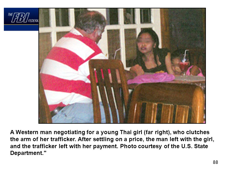 88 A Western man negotiating for a young Thai girl (far right), who clutches the arm of her trafficker.