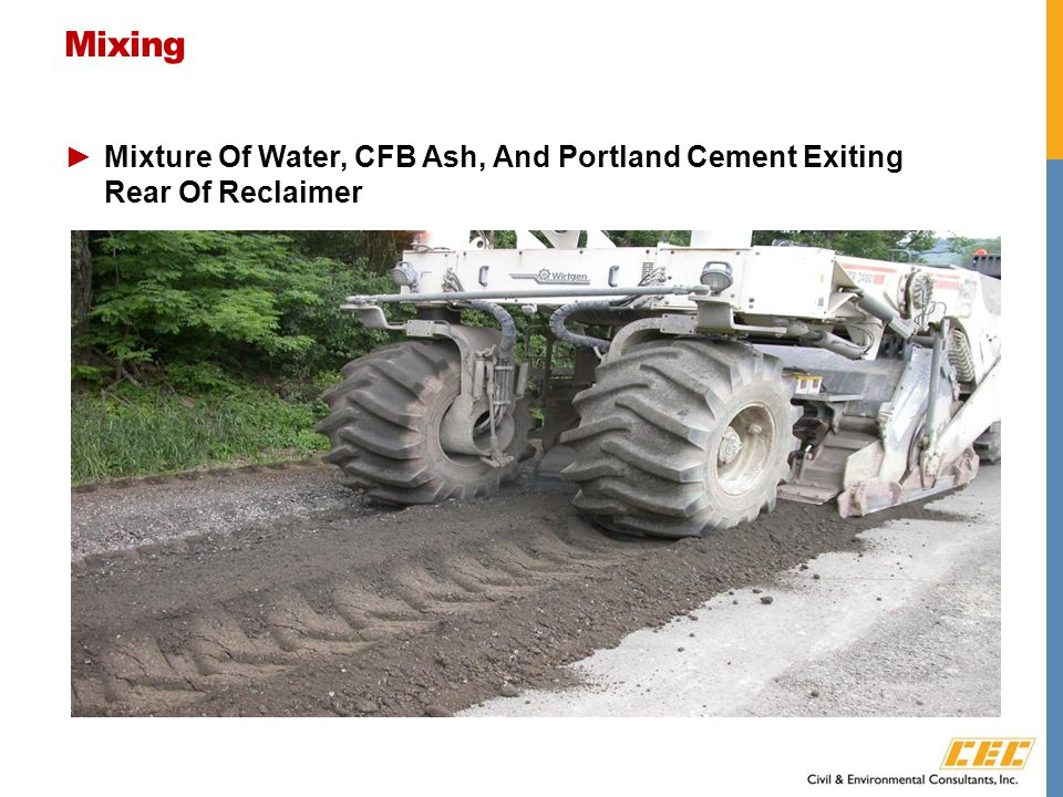 Mixing ►Mixture Of Water, CFB Ash, And Portland Cement Exiting Rear Of Reclaimer