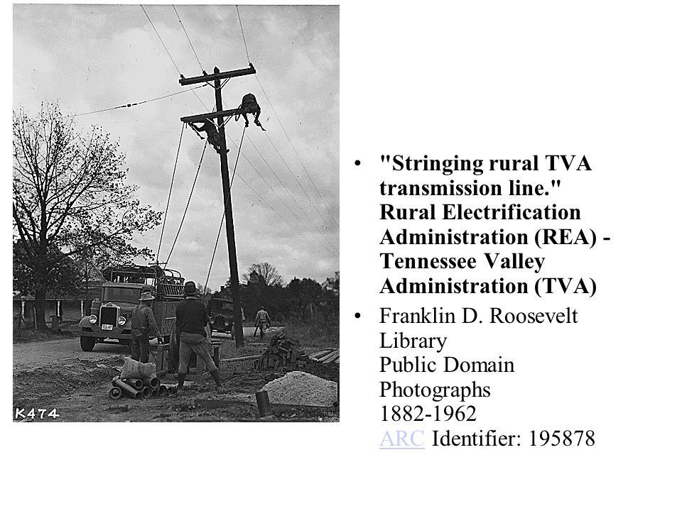 Stringing rural TVA transmission line. Rural Electrification Administration (REA) - Tennessee Valley Administration (TVA) Franklin D.