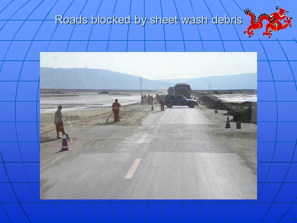Roads blocked by sheet wash debris
