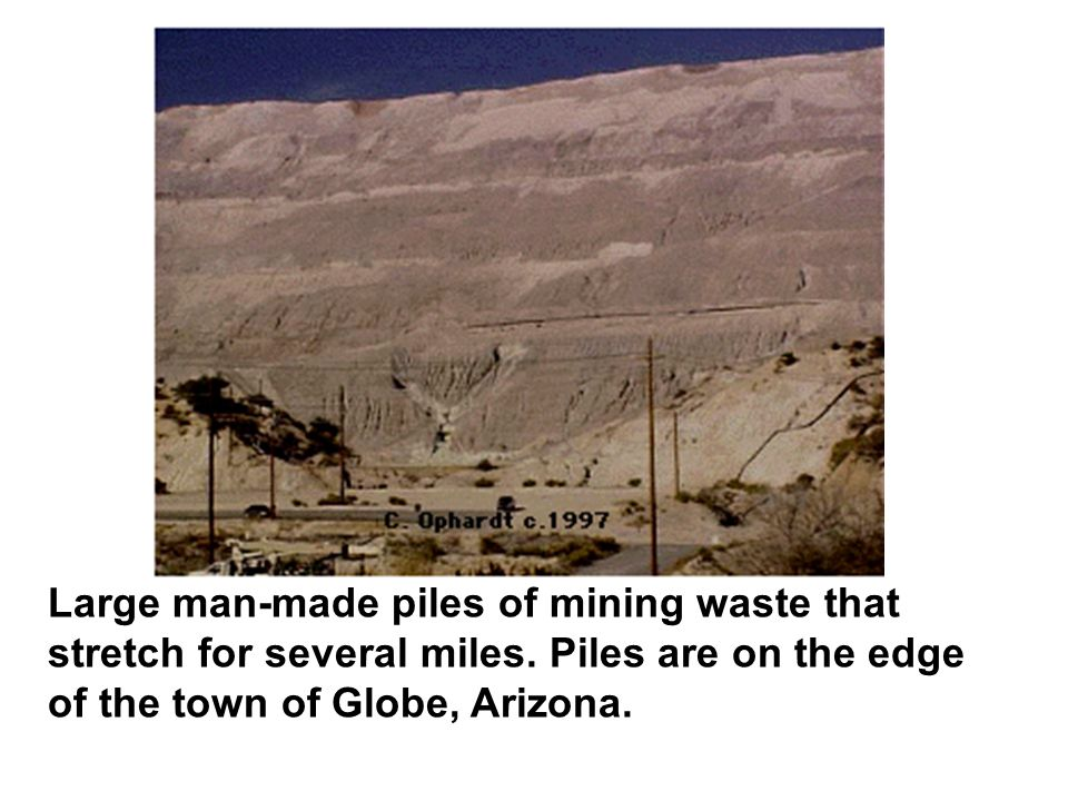 Large man-made piles of mining waste that stretch for several miles.