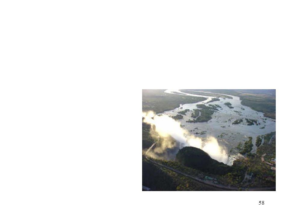 """57 Most oa Tunya  Locals call the falls """"Most oa Tunya"""", or """"The Smoke that Thunders.""""  The roar of the water can be heard long before the mist from"""