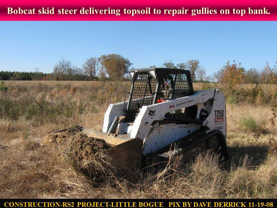 Bobcat skid steer delivering topsoil to repair gullies on top bank.