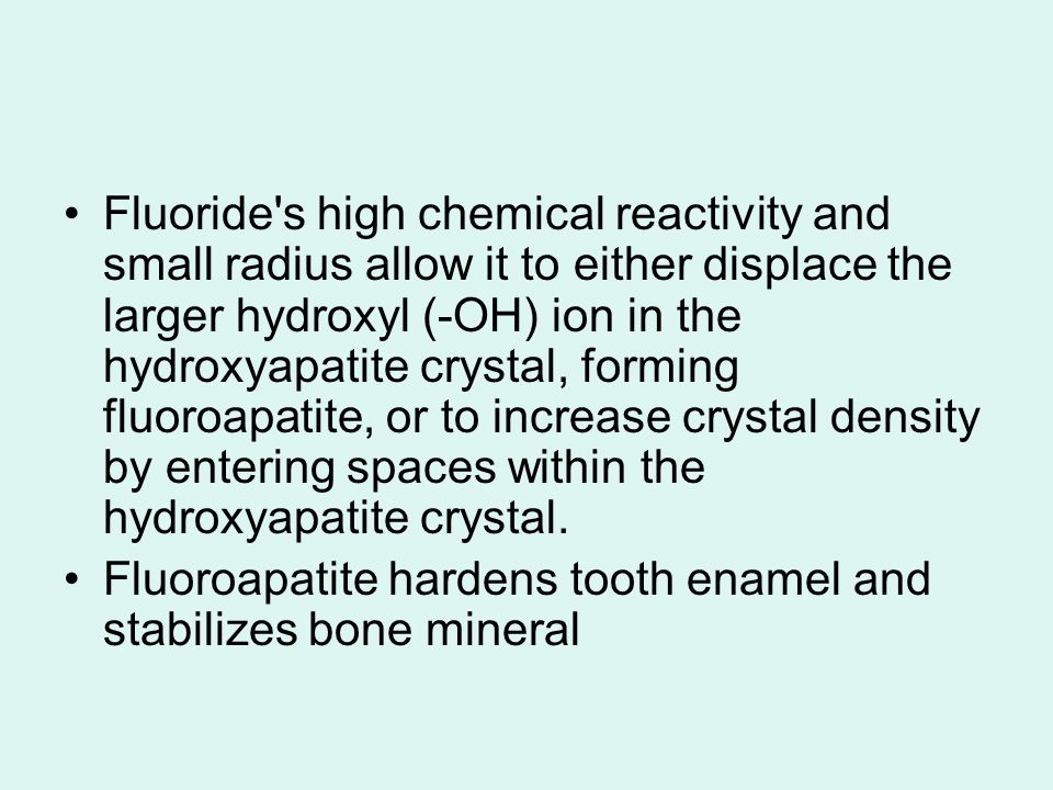Fluoride's high chemical reactivity and small radius allow it to either displace the larger hydroxyl (-OH) ion in the hydroxyapatite crystal, forming