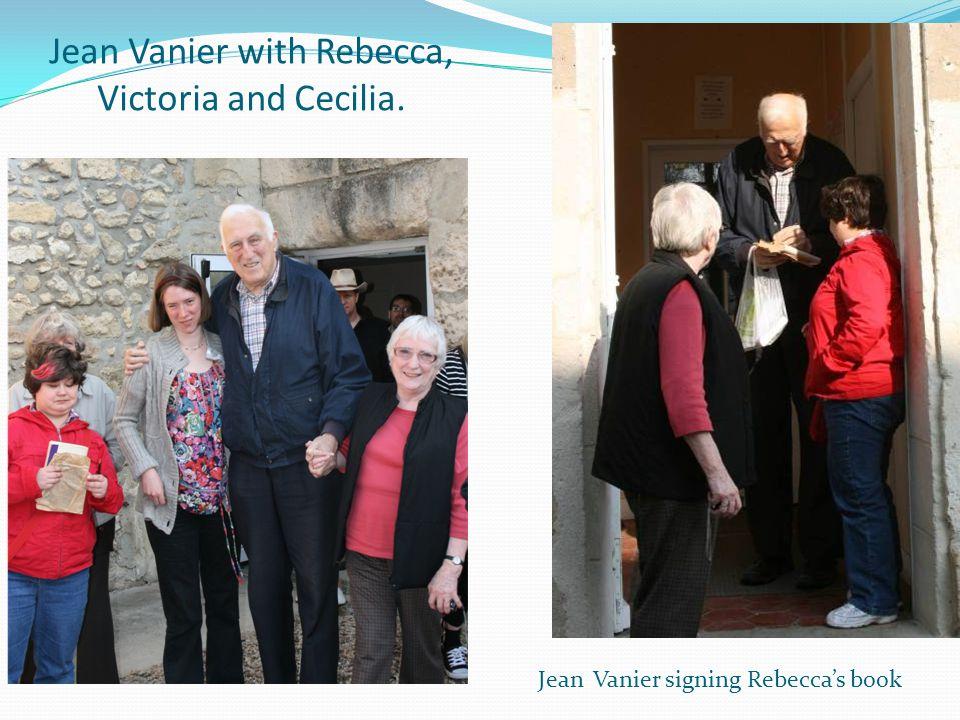 Jean Vanier with Rebecca, Victoria and Cecilia. Jean Vanier signing Rebecca's book