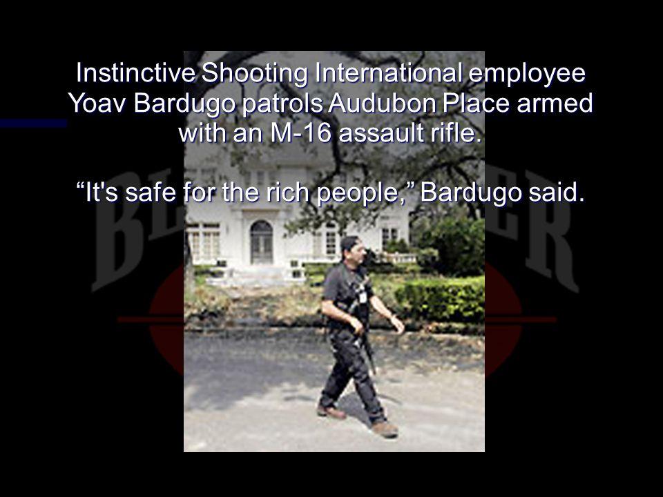 Instinctive Shooting International employee Yoav Bardugo patrols Audubon Place armed with an M-16 assault rifle.