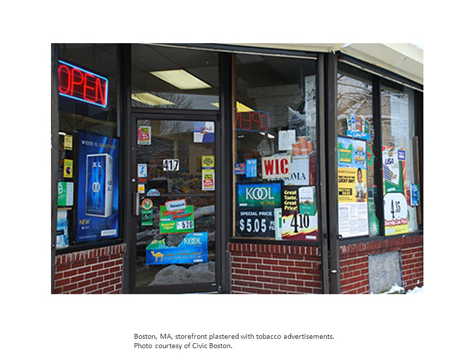Boston, MA, storefront plastered with tobacco advertisements. Photo courtesy of Civic Boston.