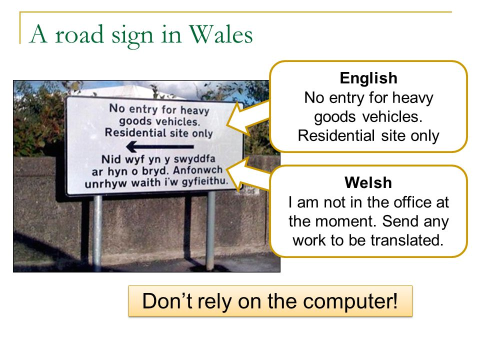 A road sign in Wales English No entry for heavy goods vehicles.