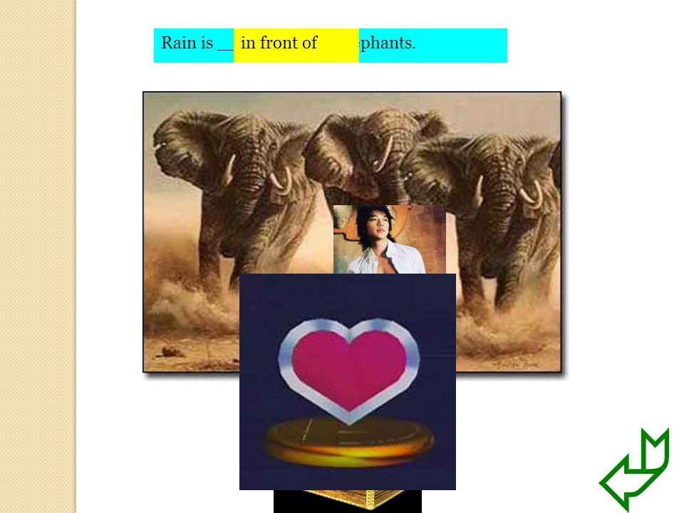 Rain is ________ the elephants.in front of