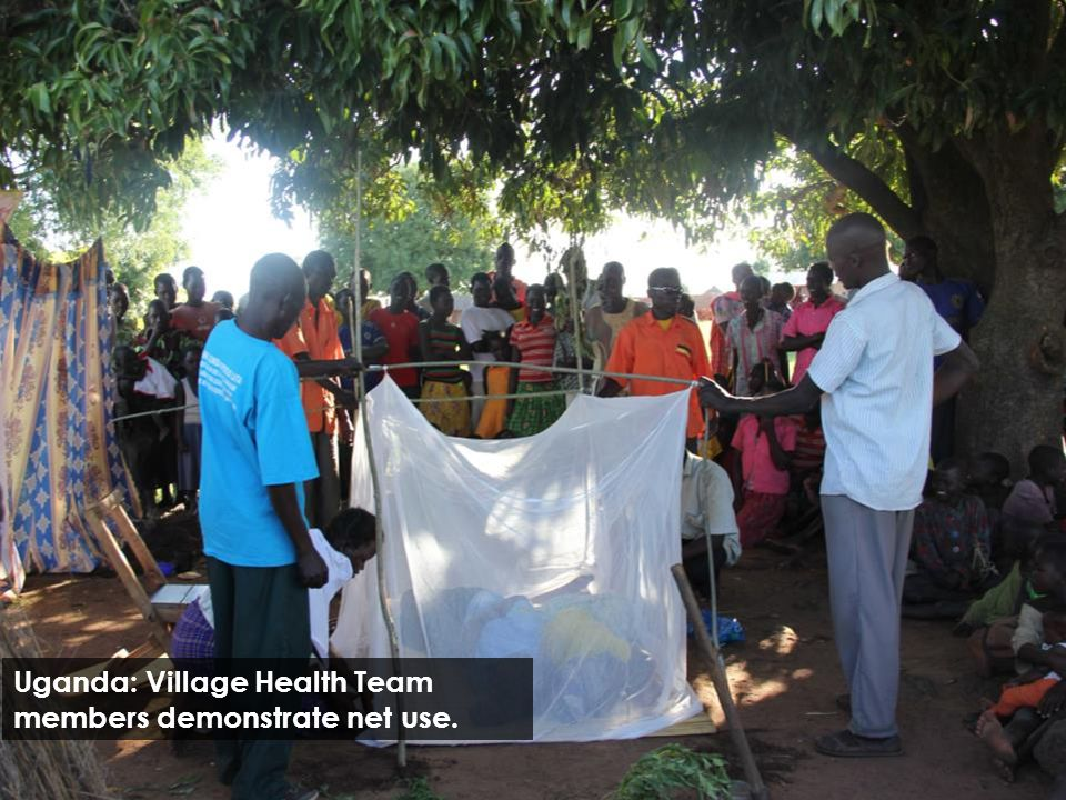 Uganda: Village Health Team members demonstrate net use.