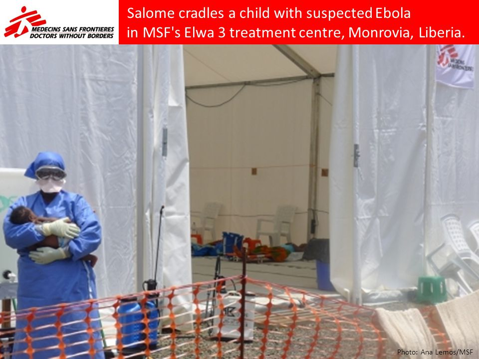 Salome cradles a child with suspected Ebola in MSF s Elwa 3 treatment centre, Monrovia, Liberia.
