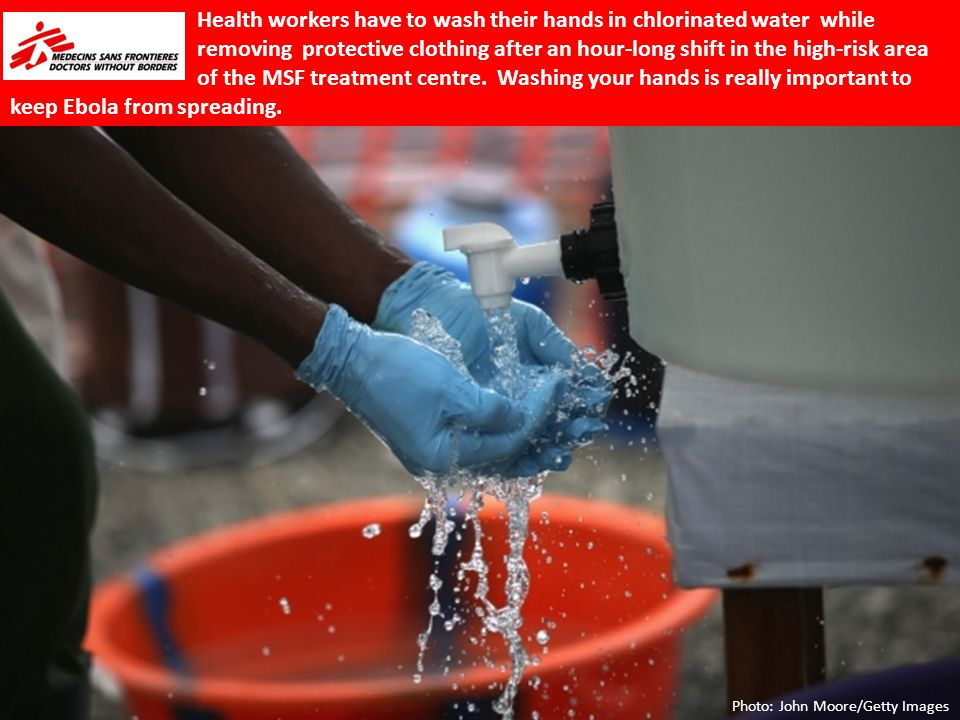Health workers have to wash their hands in chlorinated water while removing protective clothing after an hour-long shift in the high-risk area of the MSF treatment centre.