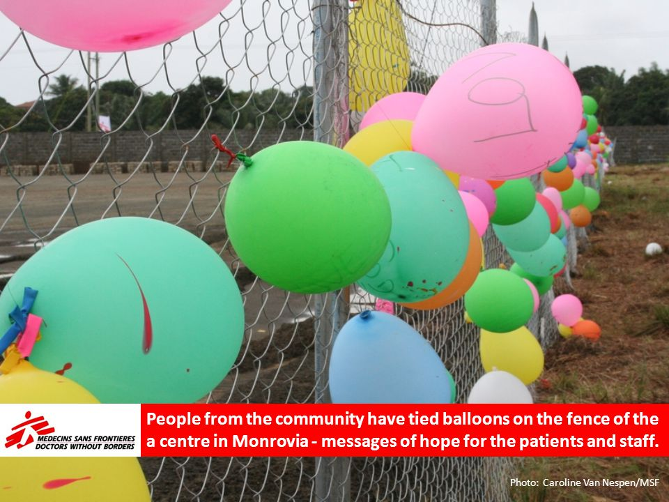 People from the community have tied balloons on the fence of the a centre in Monrovia - messages of hope for the patients and staff.