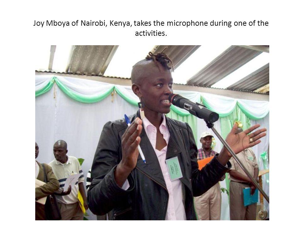 Joy Mboya of Nairobi, Kenya, takes the microphone during one of the activities.
