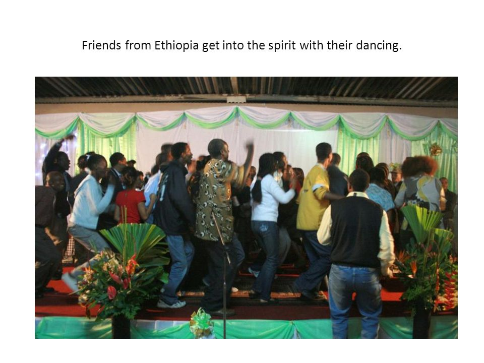 Friends from Ethiopia get into the spirit with their dancing.