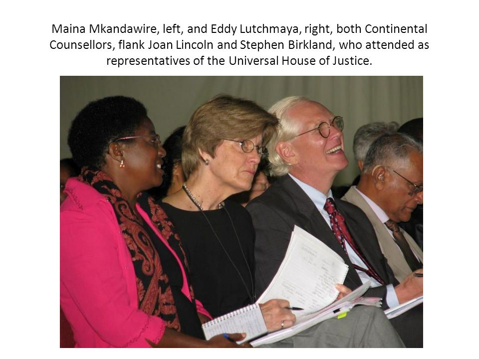 Maina Mkandawire, left, and Eddy Lutchmaya, right, both Continental Counsellors, flank Joan Lincoln and Stephen Birkland, who attended as representatives of the Universal House of Justice.
