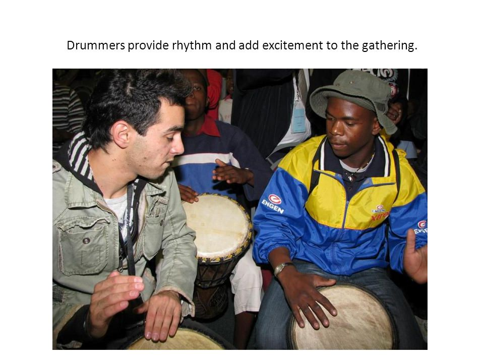 Drummers provide rhythm and add excitement to the gathering.
