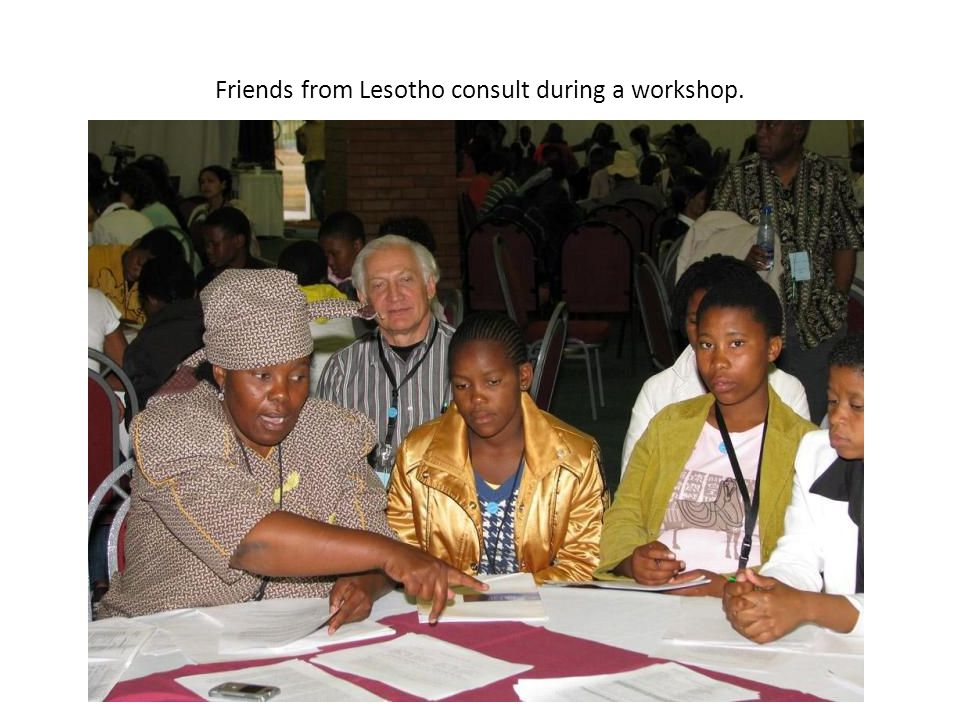 Friends from Lesotho consult during a workshop.