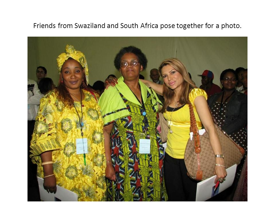 Friends from Swaziland and South Africa pose together for a photo.
