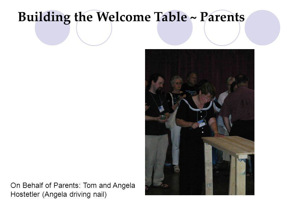 Building the Welcome Table ~ Parents On Behalf of Parents: Tom and Angela Hostetler (Angela driving nail)
