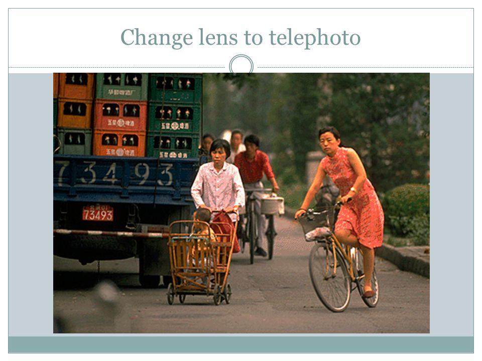 Change lens to telephoto