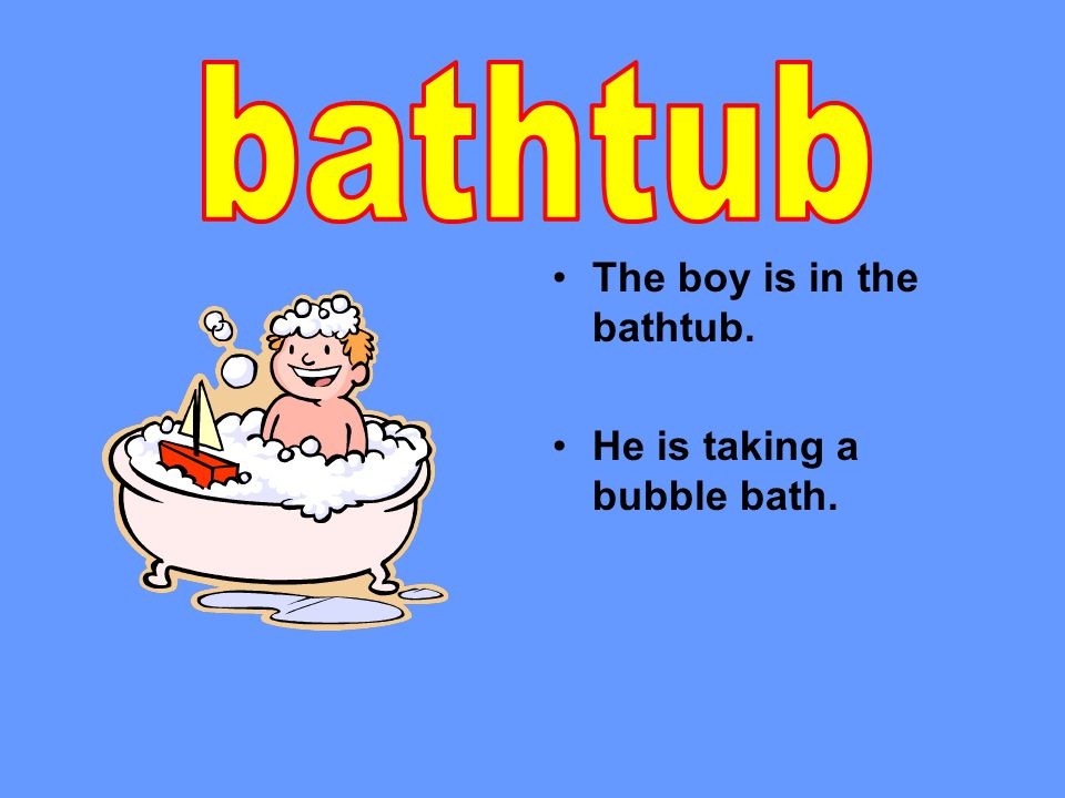 The boy is in the bathtub. He is taking a bubble bath.