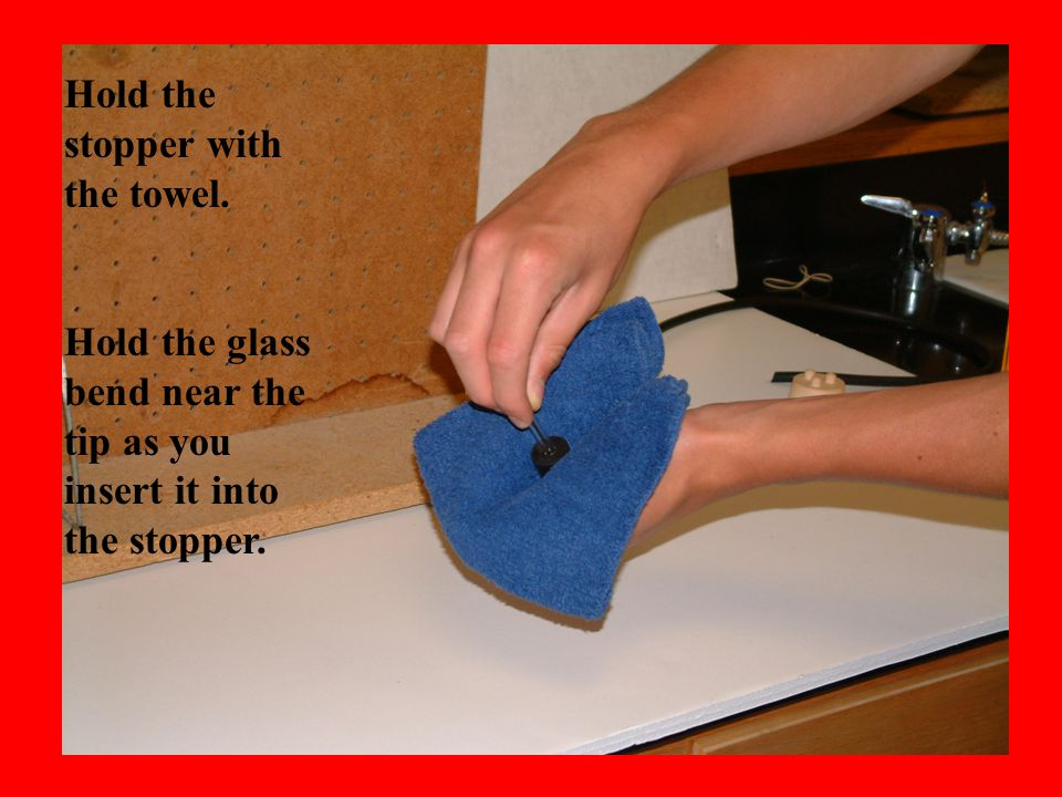 About 1/8 of the glass bend should protrude from the bottom of the stopper.