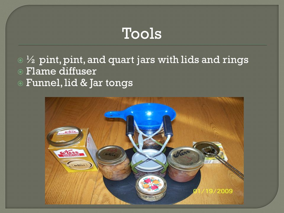  Place a towel on a counter top  Grasp jars by the neck with the jar tongs  Lift jars out of the canner and place on the towel to cool.