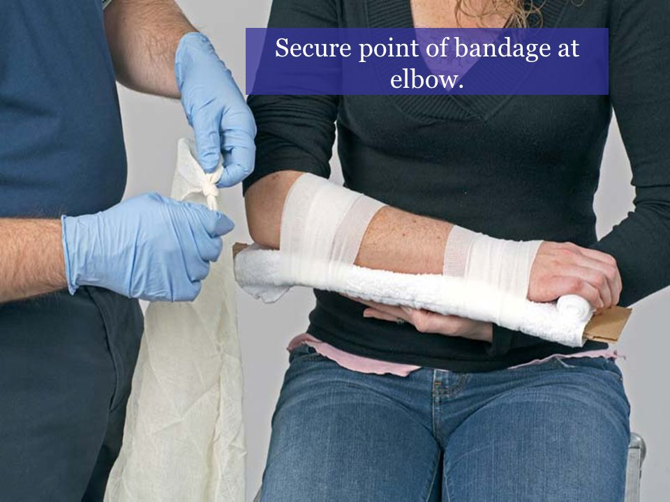 Secure point of bandage at elbow.