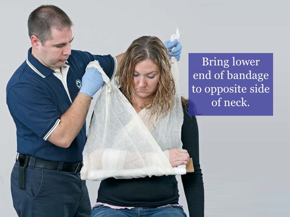 Bring lower end of bandage to opposite side of neck.