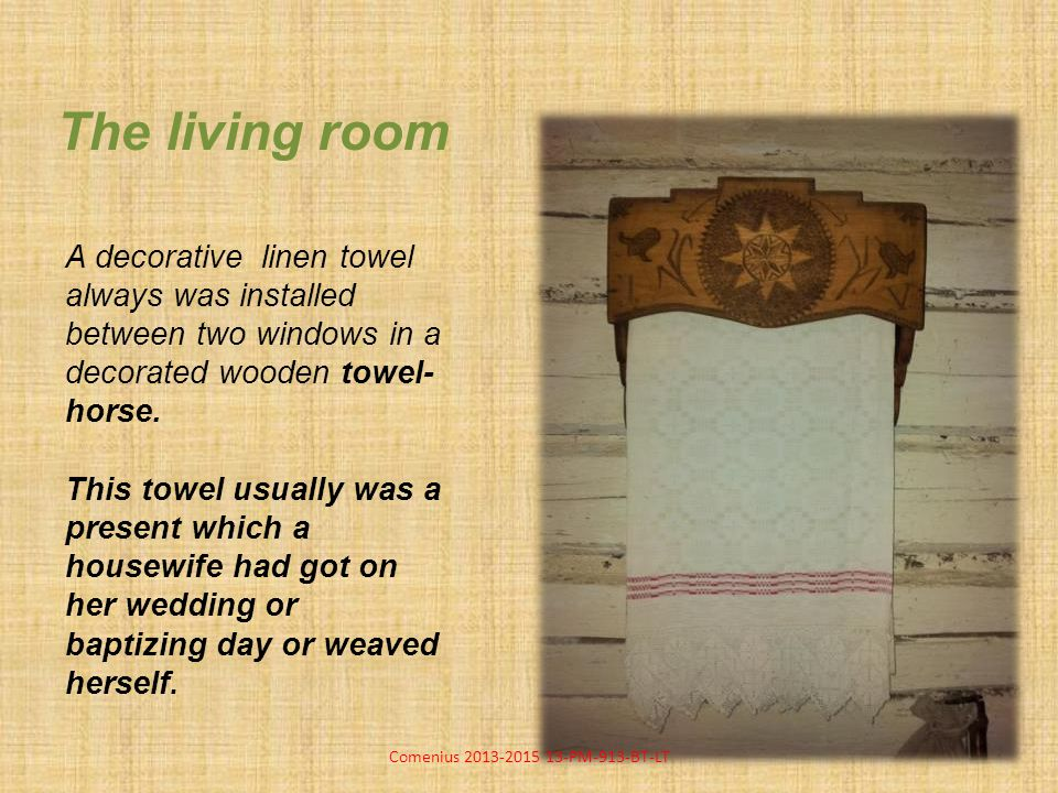 The living room A decorative linen towel always was installed between two windows in a decorated wooden towel- horse.
