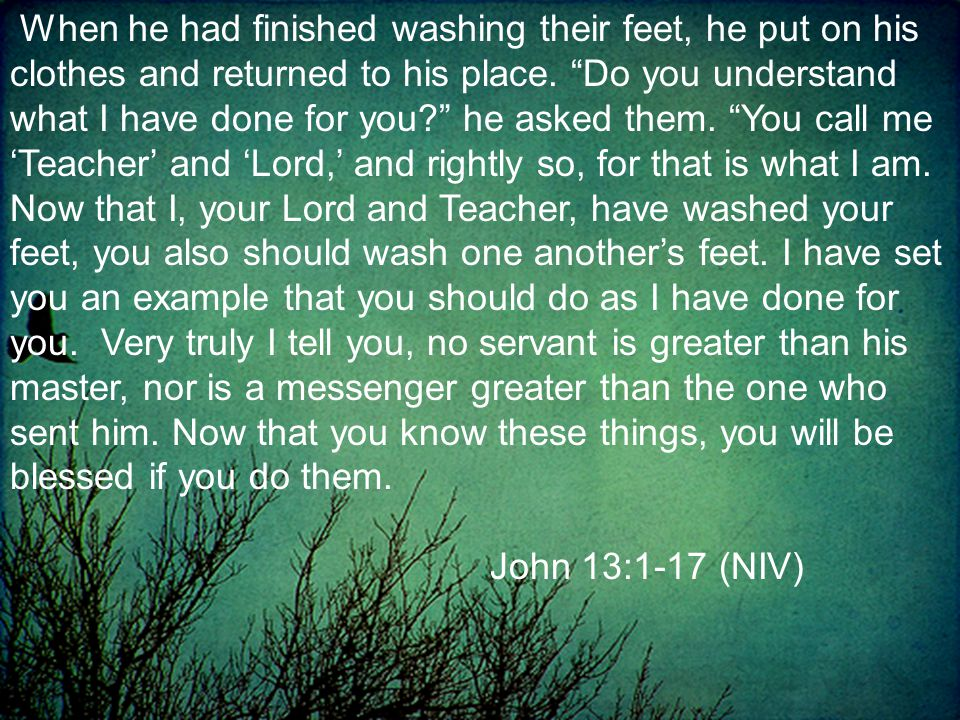 When he had finished washing their feet, he put on his clothes and returned to his place.
