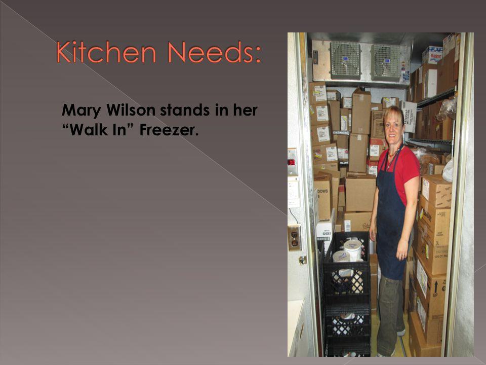 Mary Wilson stands in her Walk In Freezer.