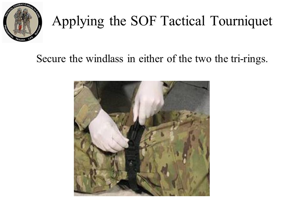 Secure the windlass in either of the two the tri-rings. Applying the SOF Tactical Tourniquet