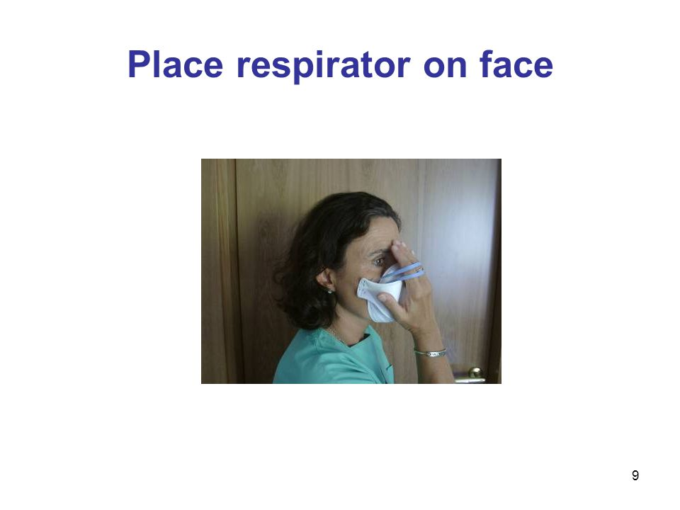 9 Place respirator on face