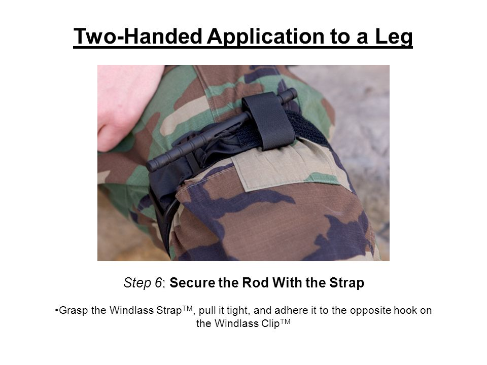: Step 6: Secure the Rod With the Strap Grasp the Windlass Strap TM, pull it tight, and adhere it to the opposite hook on the Windlass Clip TM Two-Handed Application to a Leg