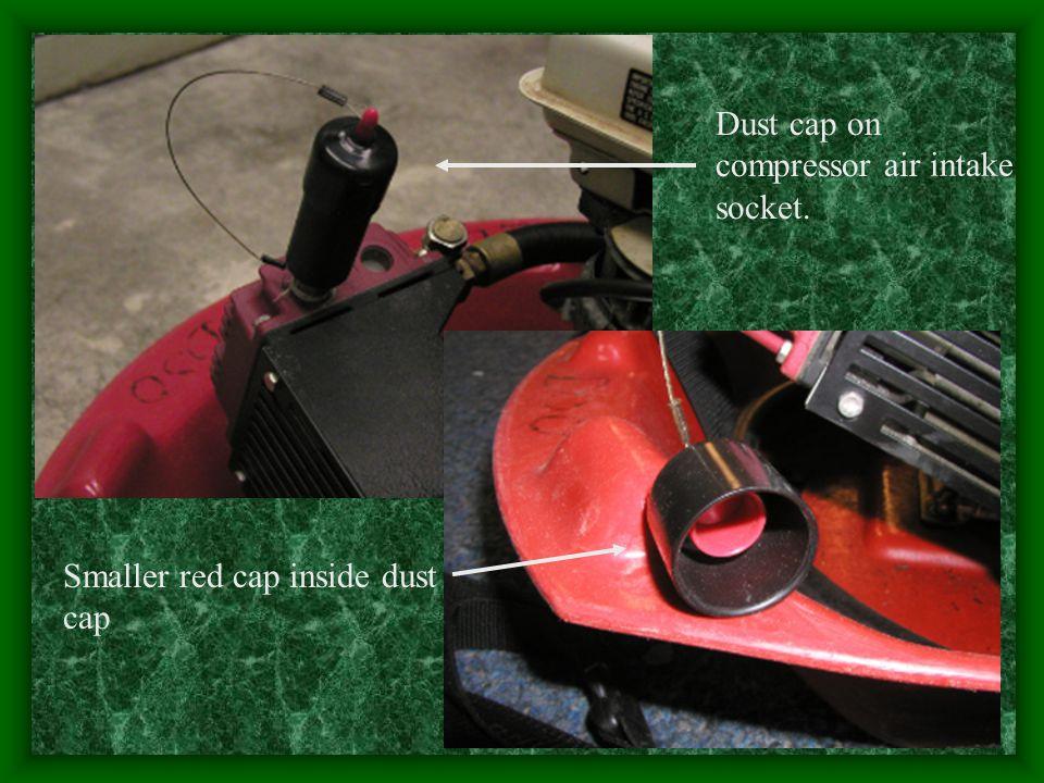 Dust cap on compressor air intake socket. Smaller red cap inside dust cap