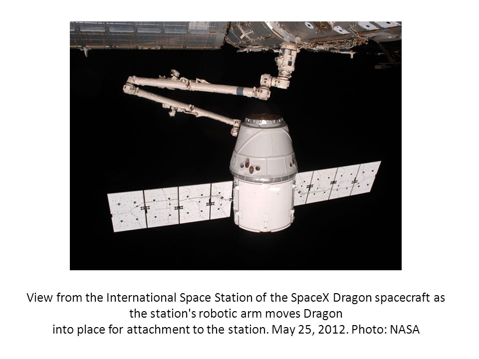 View from the International Space Station of the SpaceX Dragon spacecraft as the station s robotic arm moves Dragon into place for attachment to the station.