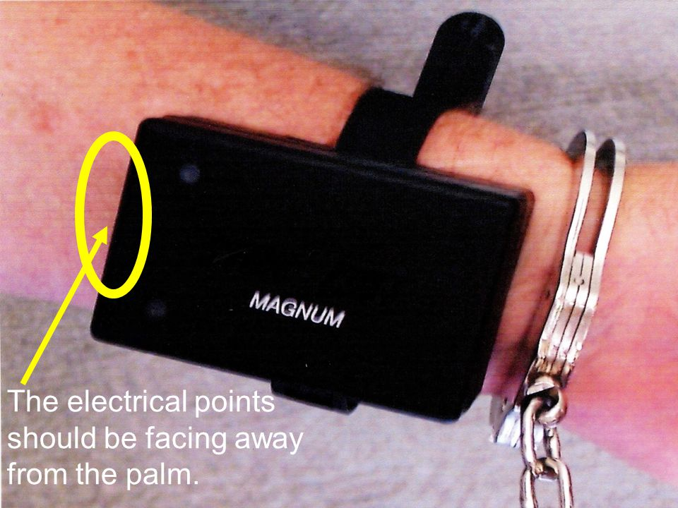 The electrical points should be facing away from the palm.